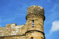 Tower at Culzean castle. A castle medieval tower towards a blue sky Stock Image