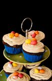Cupcakes on Black Background. A tower of cupcakes on a green stand and a black background Stock Photo