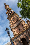 Tower decorated with azulejos on Plaza De Espana. Stock Photos
