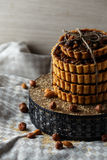 Tower of the delicious cakes with nuts on plate. Royalty Free Stock Image