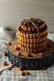 Tower of the delicious cakes with nuts on plate. Royalty Free Stock Photography