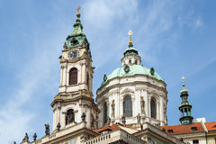 Tower and dome of St. Nicholas Church in Prague royalty free stock image