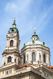 Tower and dome of St. Nicholas Church in Prague. View of tower and dome of Church of Saint Nicholas & x28;St. Nicholas Church& x29; in Mala Strana or Lesser Town Stock Photos