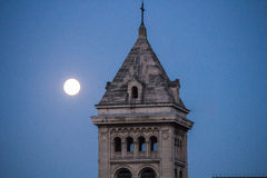 Tower of the Eglise Notre Dame des Champs, with full moon, Paris Royalty Free Stock Image