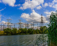 Tower electrical substation on the other side of the river. stock images