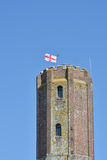 Castle tower with english  flag. Tower with english george cross flag Stock Photo