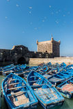 The tower of Essaouira with blue boats Stock Photos