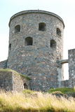 Tower Fars Hatt at Bohus fortress vertical. Stone tower Fars Hatt at Bohus fortress vertical, Nordic historic site, more than 700 years old, unsuccessfully stock images