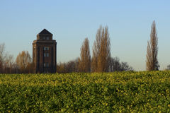 Tower in the field Royalty Free Stock Photo