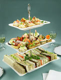 Tower Of Finger Food. Delicious assorted finger food and sandwiches on a three tier stand stock images