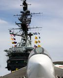 Tower and flags and fighter jet on the USS Midway Stock Image