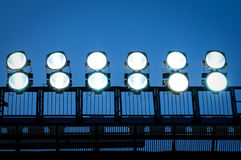 Tower with floodlights. Tower with lighting floodlights at the stadium Royalty Free Stock Photo