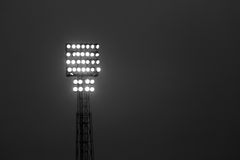 Tower floodlights with many floodlights during the night show. Immense tower lighthouse with many floodlights during the night show Stock Image