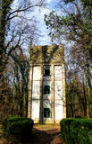Tower in the forest. Deserted water tower in the forest Royalty Free Stock Images