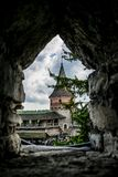 Tower of the fortress through the loophole. Yard of ancient Kamianets-Podilskyi Castle stock photos