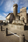 Tower, fountain and plaza of the village of Bagnaia. Italy Stock Images