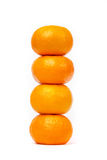 Tower of four tangerine isolated on white Royalty Free Stock Image