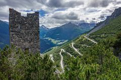 Tower of Fraele and ascent, Touristic attraction in Valtellina. U-shape curved road towards Towers of Fraele with tower in the foreground, a Touristic attraction Royalty Free Stock Photo