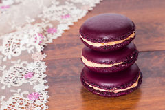 Tower from french macarons on a wood bacground Stock Photos
