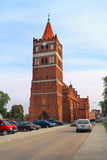 Tower of Friedland's Lutheran church with a clock in Gothic style Royalty Free Stock Image