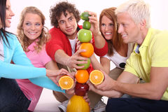 Tower fruits. Five person build tower in studio Royalty Free Stock Photo