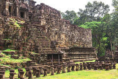 Tower and galleries in Angkor Thom, Baphuon Temple. Tower and galleries and walking tourists at sunny morning in Angkor Thom, Baphuon Temple, Siem Reap, Cambodia Royalty Free Stock Photos