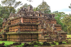 Tower and galleries in Angkor Thom, Siem Reap, Cambodia. Tower and galleries and walking tourists at sunny morning in Angkor Thom, Siem Reap, Cambodia Stock Image