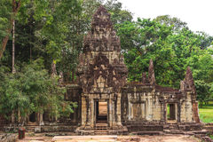 Tower and galleries in Angkor Thom, Siem Reap, Cambodia. Tower and galleries and walking tourists at sunny morning in Angkor Thom, Siem Reap, Cambodia Stock Photos