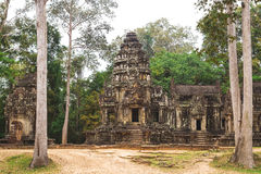 Tower and galleries in Angkor Thom, Siem Reap, Cambodia. Tower and galleries and walking tourists at sunny morning in Angkor Thom, Siem Reap, Cambodia Royalty Free Stock Images