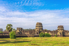 Tower and galleries of Angkor Wat Temple at morning. Tower and galleries of Angkor Wat Temple at sunny morning. Siem Reap, Cambodia Royalty Free Stock Photos
