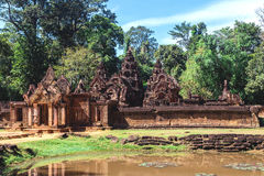 Tower and galleries in Banteay Srei, Siem Reap, Cambodia. Tower and galleries at sunny morning in Banteay Srei Temple, Siem Reap, Cambodia Royalty Free Stock Image