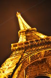 The tower of gold. Eiffel Tower at night in Paris illuminated Stock Photos