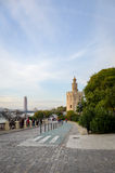 Tower of gold in Seville - promenade. Seville, Spain - January 17, 2015: Promenade along the river with Tower of gold, (Torre del Oro) in the background. Local Royalty Free Stock Photography