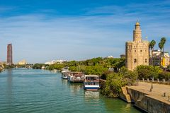 Tower of gold Torre del Oro with Guadalquivir river in Sevilla, Spain. Tower of gold Torre del Oro with Guadalquivir river in Sevilla - Spain stock photos