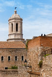 Tower of the gothic cathedral of Girona. Seen from the old neighborhood, tourism in Catalonia, Spain Royalty Free Stock Photo