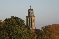 Churchtower behind colorful trees in autumn, Deventer, The Netherlands Royalty Free Stock Image