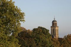 Churchtower behind colorful trees in autumn, Deventer, The Netherlands Royalty Free Stock Photo