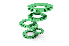Tower of green colored metallic cogwheels hovering Stock Photography