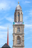 Tower of the Grossmunster with a banner Royalty Free Stock Images