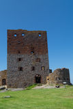 The tower of Hammershus Castle. The ruins of the central tower of the medieval castle of Hammershus at Bornholm, Denmark Royalty Free Stock Images