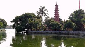 The pagoda tower bears the shape of a lotus flower blooming on the lak stock photo