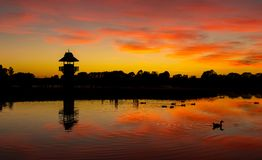 Tower of Henley Lake. Still waters at Henley Lake Park, Masterton, New Zealand at dawn royalty free stock photography
