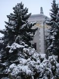 А tower hidden among the snow-covered firs., a tower among spruce trees stock photography