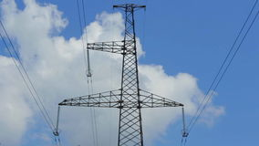 Tower with high voltage electricity from the metal wires in the grass stock video