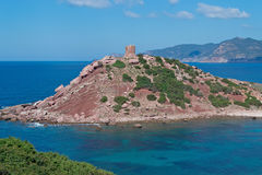 Tower on the hill. Sighting tower in Porticciolo, Sardinia Stock Image