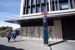 Tower Hill underground tube station entrance. Featuring drawings of people stock image