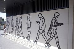 Tower Hill underground tube station entrance. Featuring drawings of people stock photography