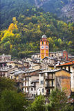 Tower with hours. Houses of poor small city in mountains Royalty Free Stock Photo