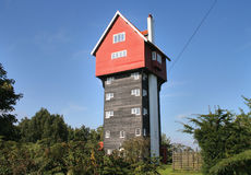 A Tower House in Rural England. A House in the Clouds in Rural England against a clear Blue Summer Sky Stock Photography