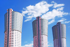 Tower-houses, similar to the large smokestacks Stock Photography